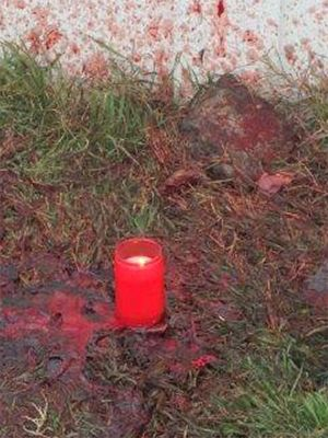 December 2015: Candle lit at the market of Calarasi, Romania, for the souls of the slaughtered pigs.